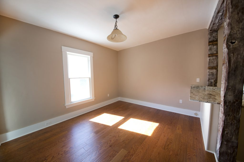 Spacious room with wood flooring