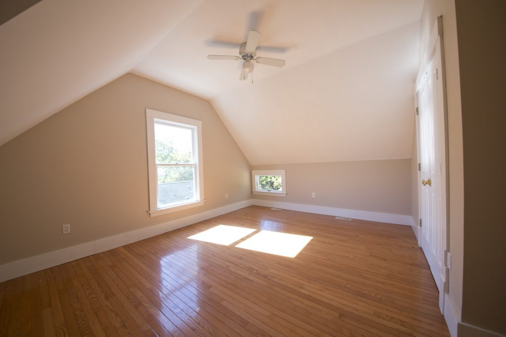 Spacious room with ceiling fan