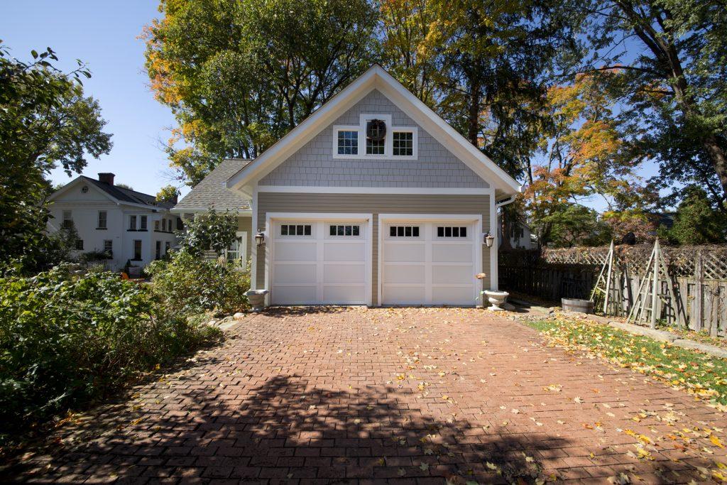 Garage with brick driveway