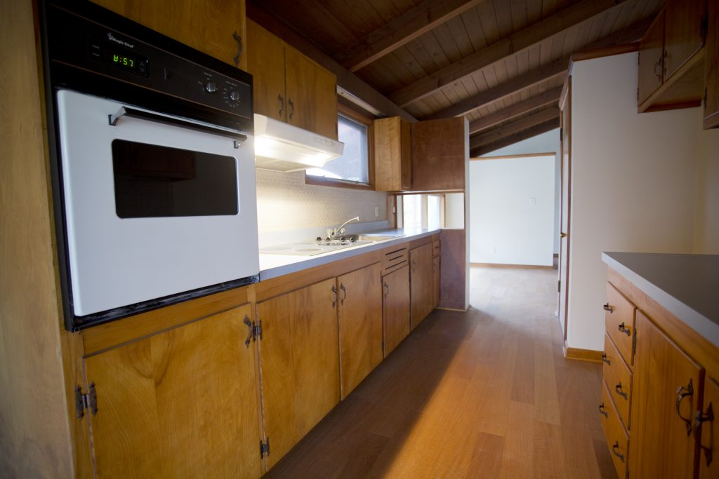 Wooden kitchen with oven