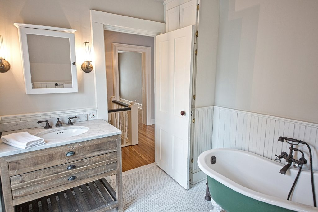 Bathroom with wooden bathroom countertop