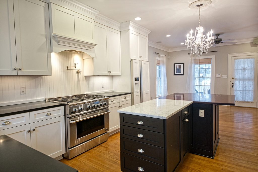 Kitchen with countertop and black cabinetry