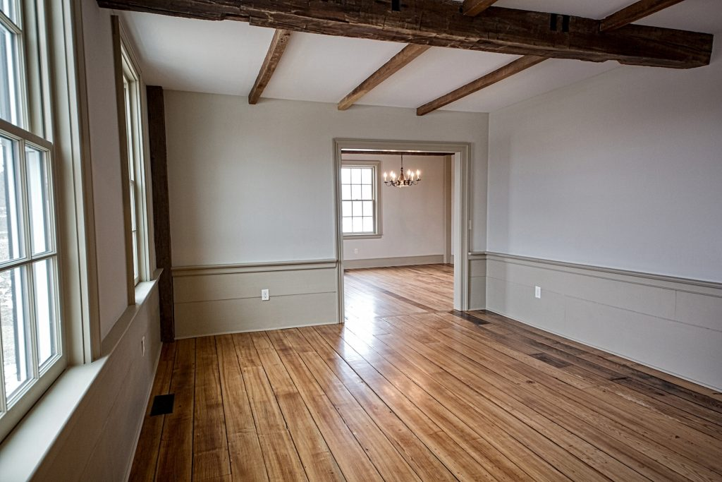 Spacious room with chestnut flooring