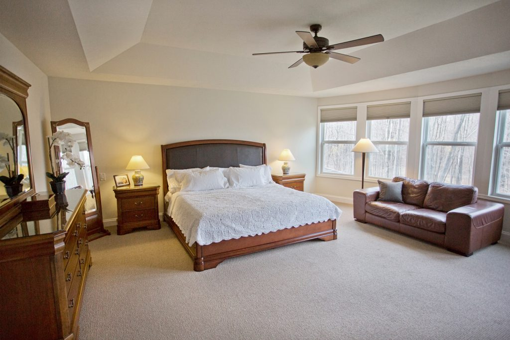 Bedroom with brown leather sofa
