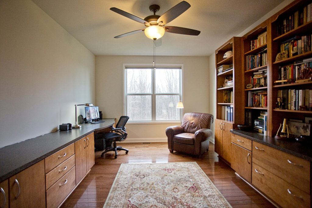Library with custom made cabinetry bookshelves and spacious desk