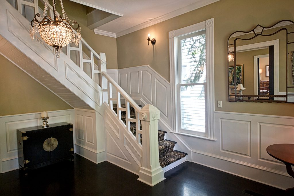 Carpeted white staircase