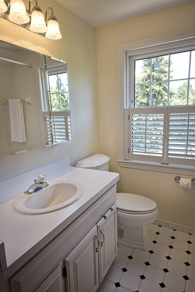 Bathroom with black and white ceramic tile