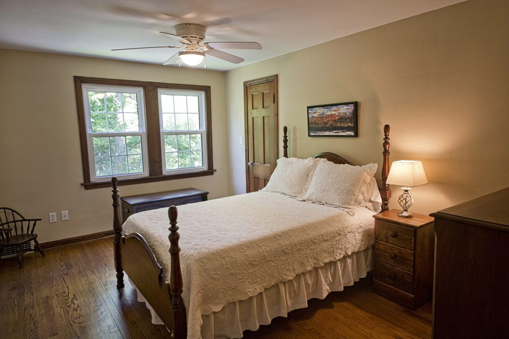 Lovely bedroom with ceiling fan