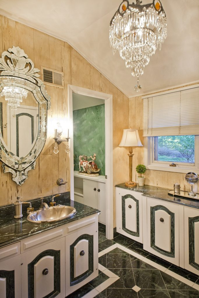 Bathroom with elegant chandelier