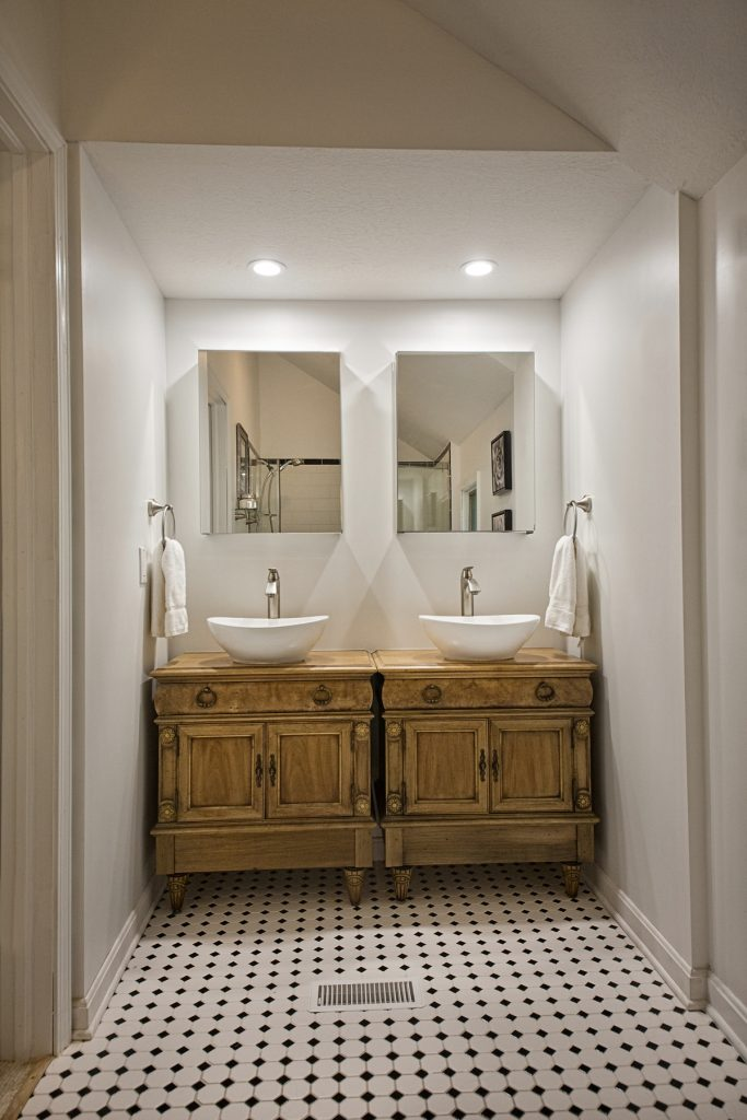 Bathroom with double sinks and wooden cabinet