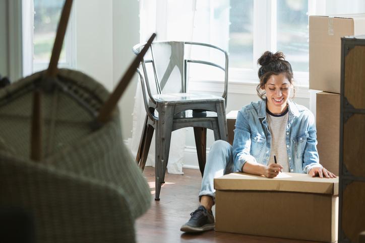 Woman writing checklist