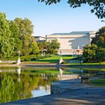 The Cleveland Museum of Art and trees reflected in Wade Lagoon, Cleveland Ohio