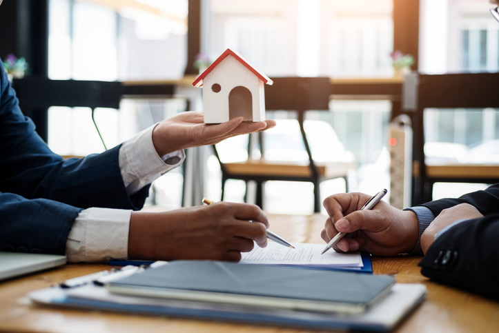 Real estate broker explain contract investment before signing a contract housing estate in office. contract and agreement concept.