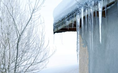 large icicles hanging from the roof