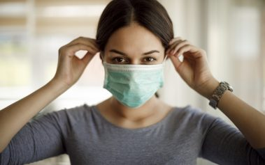 Young woman on a protective mask