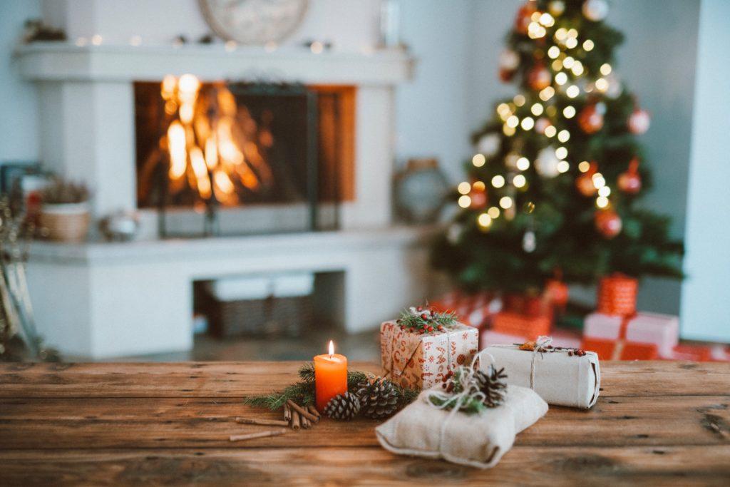 Christmas Tree beside A Fireplace