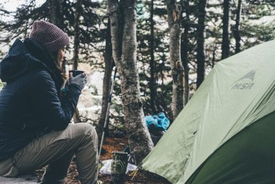 woman sitting in a camping site in OH, things to do in Cleveland