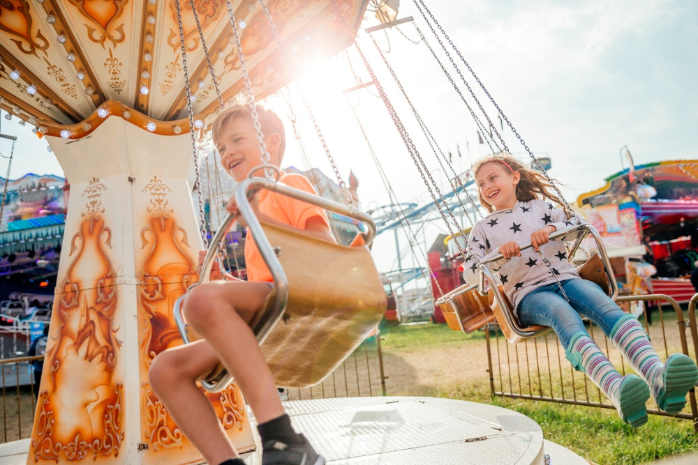 Children Riding on the Swings